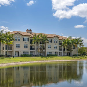exterior of apartment building by pond
